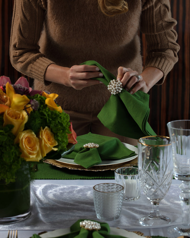 Angie of Angie's Tables setting up the Evergreen Tablescape