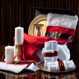 Father Christmas Tablescape  Kit items including gold chargers, santa napkin rings, red santa tablerunner with fur trim, candles with gold candle holders