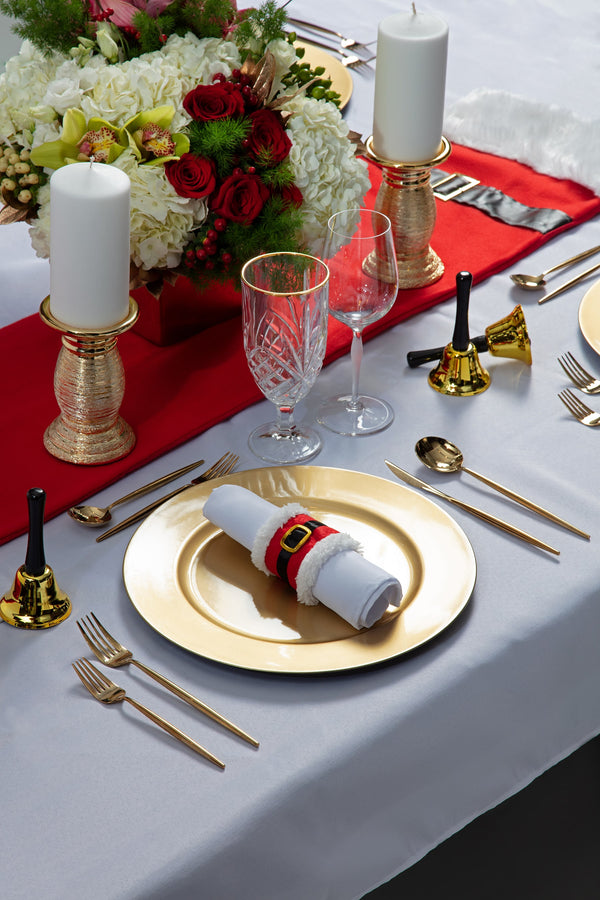 Angie's Tables Father Christmas Tablescape single setting with gold charger, santa napkin ring, on white tablecloth