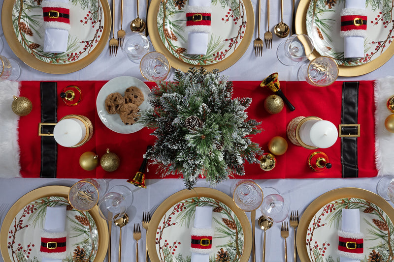 Angie's Tables overhead view of the Father Christmas Tablescape with gorgeous evergreen display and red santa details.