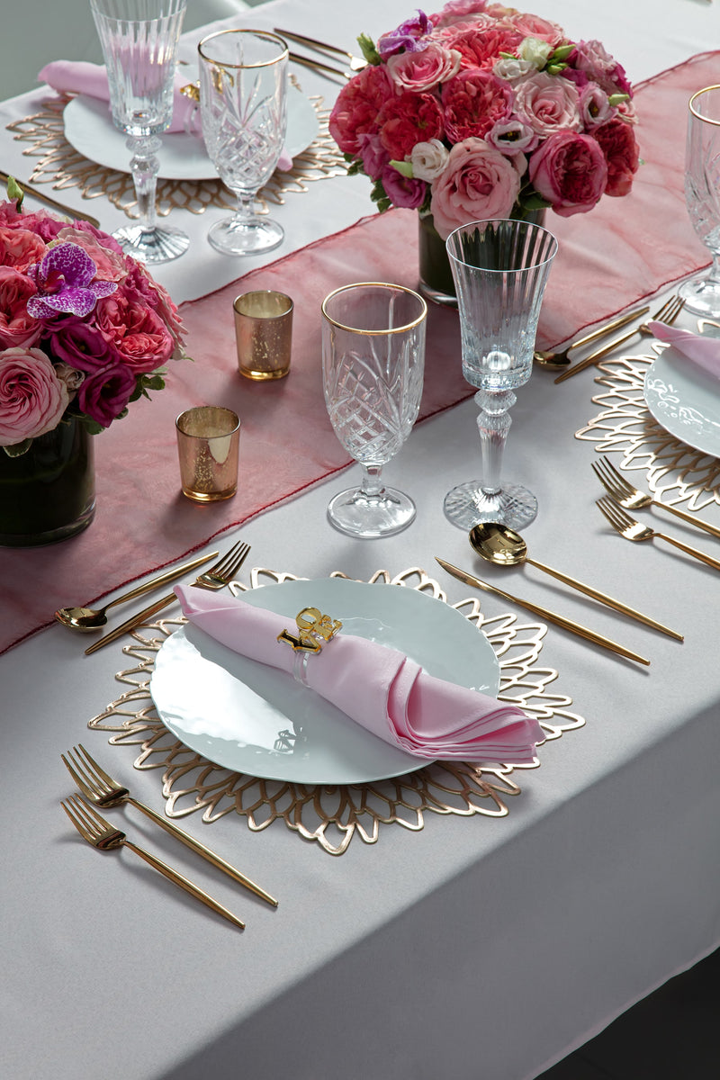 Angie's Tables Love is in the Air Valentine Tablescape single setting with gold placemat and pink napkins, love napkin ring, gold candle holders.