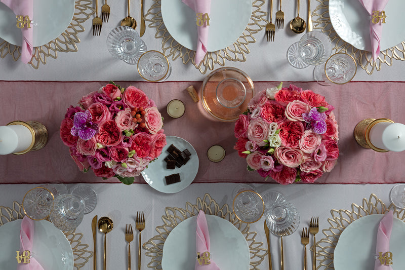 Angie's Tables overhead of the Love is in the Air Valentines Tablescape kit with gorgeous floral display and pink accents.