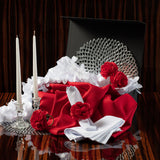 Will you be my Valentine Tablescape Kit items including silver chargers, white napkins, red carnation napkin rings, candles and red tablecloth.