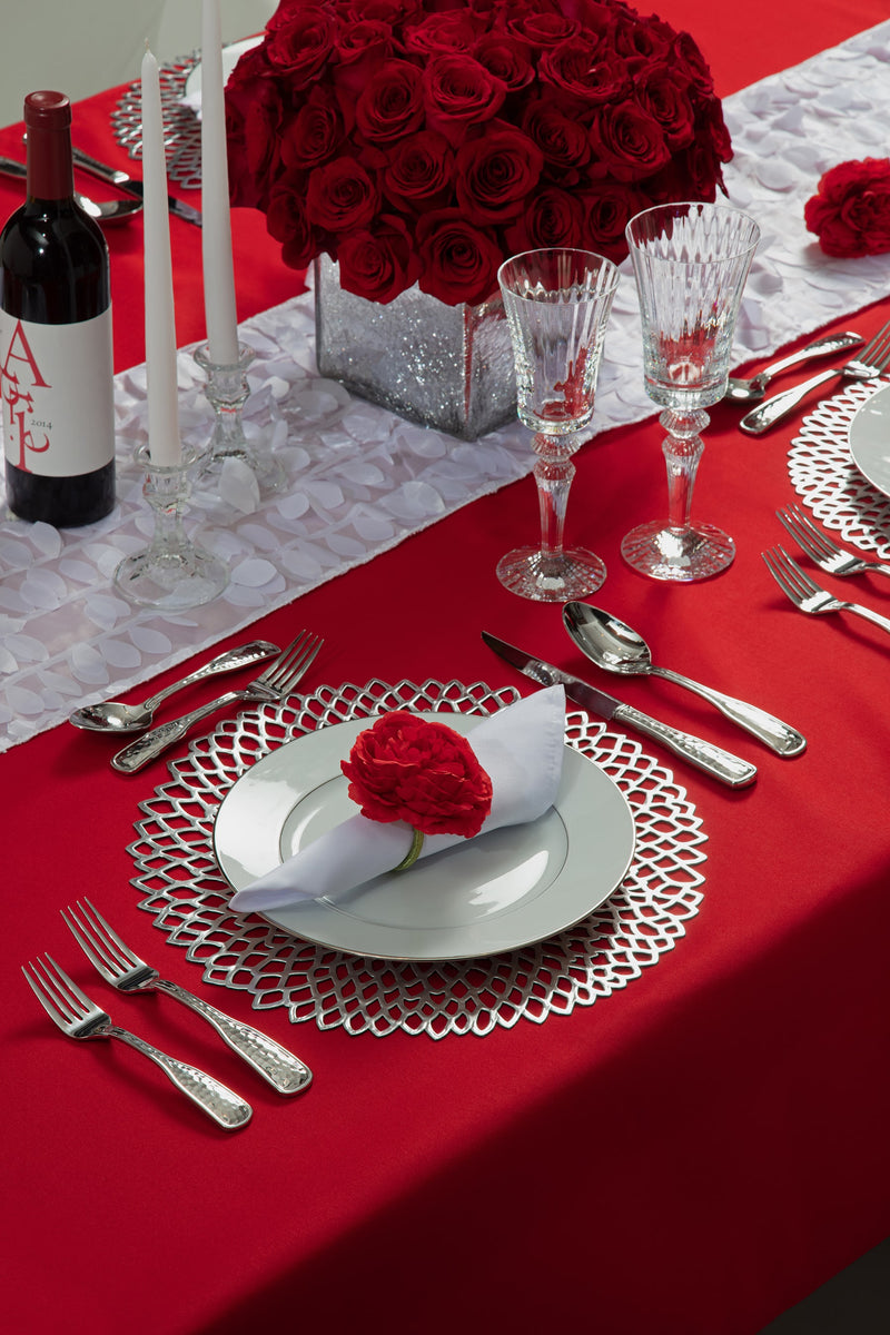 Angie's Tables Will you be my Valentine Tablescape single setting with silver chargers, white napkins, red carnation napkin ring on red tablecloth