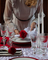 Angie of Angie's Tables setting up the Will you be my Valentine Tablecape, perfect for Valentine's Day.
