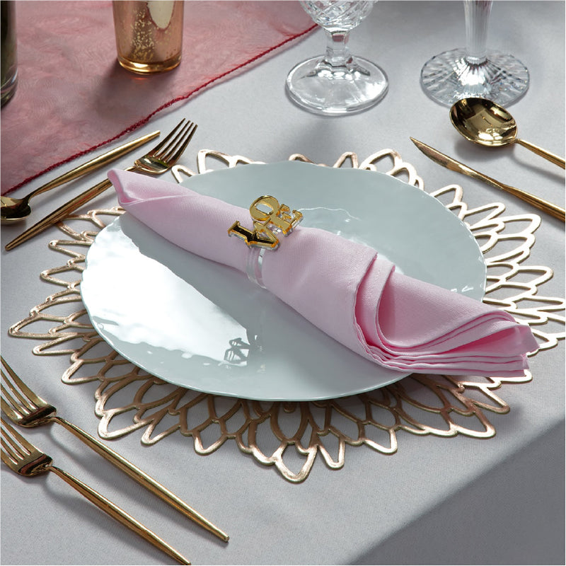 Love is in the Air Valentine Tablescape extra setting including a napkin, a love napkin ring, and a gold charger.