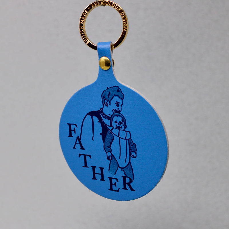 A lovely idea for a new father, a warm design for a key ring of a father and new born baby, sold by Percy Langley