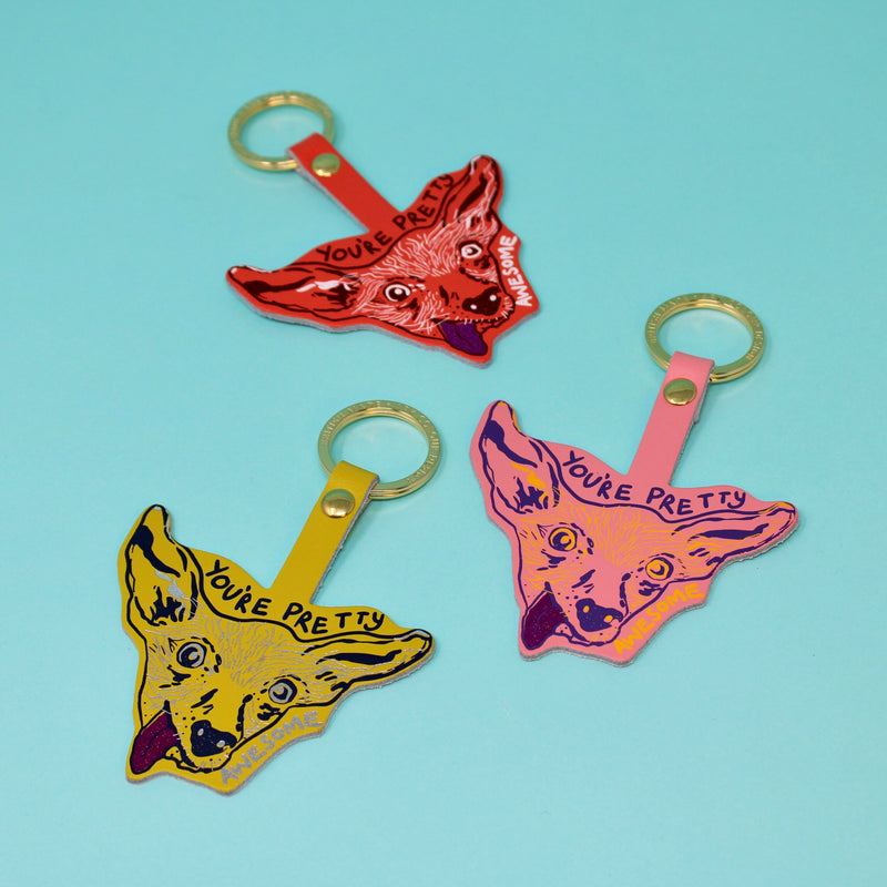Genuine leather key fobs or key rings with a gold plated ring and fun designs, sold by Percy Langley