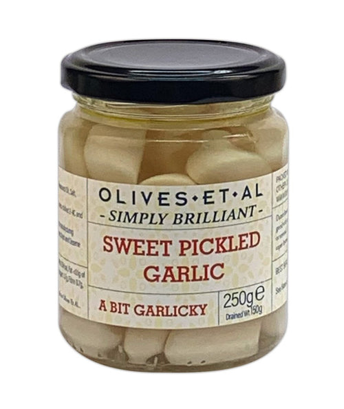 Deli counter style sweet pickled garlic, 250g jar. Fans of the Deli counter can now enjoy the Olives et Al Simply Brilliant range, designed during the pandemic by the team at Olives et Al to deliver deli food as safely as possible here jars pack all the flavour whilst staying firmly sealed. Recommend for garlic lovers to get crunching on one of natures gifts!