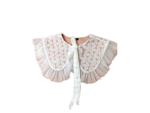 Striking and easy to wear large white peter pan collar made from delicate lace.  Edged in a delicate mesh fabric with gathered edging and long ties at the front that look wonderful tied in a bow.  The wonderful thing about these collars is that it takes minimal effort to dress up.    Handmade by Minkie in their London studio, this collar is a beautiful way to instantly update your wardrobe.