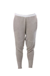 Knitted relaxed trousers by London based knitwear designer Valentina Karellas.  Grey knitted trousers with contrast waistband and bright orange pockets, ribbed hem and ripple knee detailing. Super soft designed for maximum comfort. Can be dressed up or enjoyed as a relaxed style. One size fits all. 90% Flax Viscose, 10% Cotton, with internal elastic waistband.