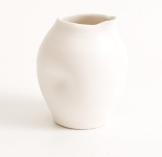 A quirky and unique bottle from Linda Bloomfield, white thrown porcelain with noticeable dimples, sold by Percy Langley