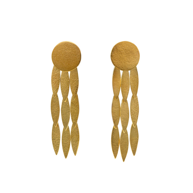 The Icarus Large Sun Drop Earrings are a contemporary statement earring with fantastic movement that shimmer in the light. The are made from Gold vermeil and measure 1.6cm x 6cm  Cara Tonkin designs beautiful, elegant and bold jewellery for stylish and strong-minded women. Her work marries classic and contemporary design to create unique, timeless pieces.   Note that this item is shipped directly from Cara Tonkin