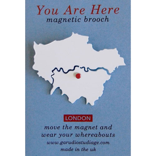 Fun brooch for young and old. Move the red enamelled magnet around the map of London as you travel Brooch: 50mm high, 0.7mm thick powder coated steel, with metal pin on the back. Card packaging: 60 x 90mm. Red enamelled magnet: 3mm diameter super strength magnet Not recommended for young children due to small parts and pin fastening.
