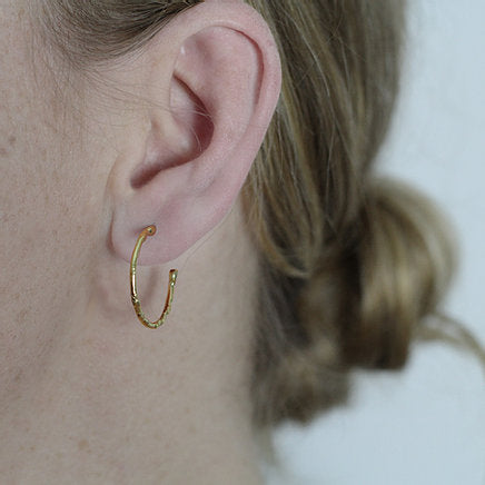 Medium textured hoops made out of fairmined gold vermeil by April March Jewellery, sold by Percy Langley