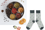 7 fragrant botanicals, gin patterned socks and lip balm