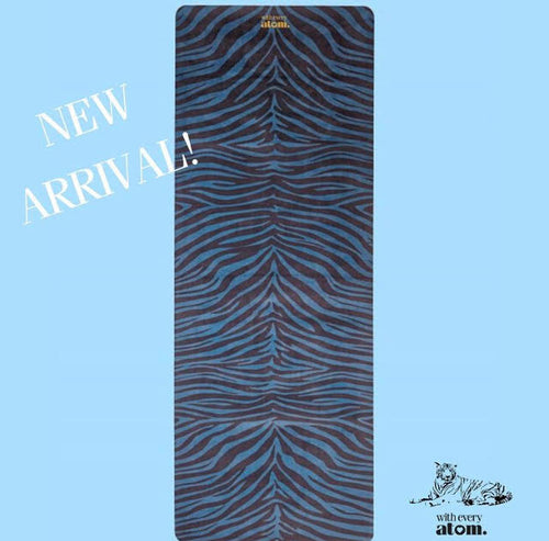 Eco-friendly travel yoga mat with tiger print by With Every Atom. Fully biodegradable base made from 100% natural rubber, patterned with water-based inks, the yoga mat is completely toxin-free.