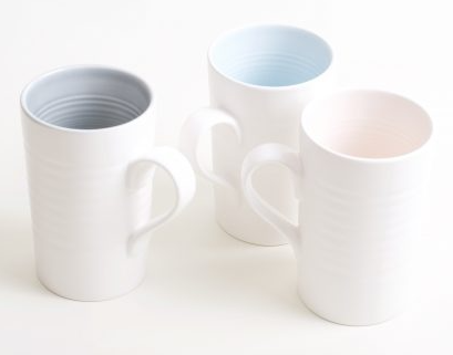 These elegant mugs have a subtle coloured glaze on the inside and a tactile satin matt glaze on the outside, making them a stylish and sturdy mug for your hot drinks, sold by Percy Langley