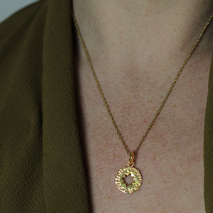 Star Amulet Pendant made out of fairmined gold vermeil by April March Jewellery, sold by Percy Langley