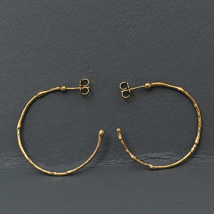 Large textured hoops made out of fairmined gold vermeil by April March Jewellery, sold by Percy Langley