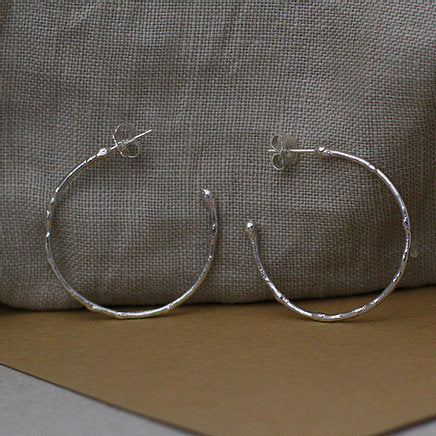Large textured hoops made out of recycled silver by April March Jewellery, sold by Percy Langley
