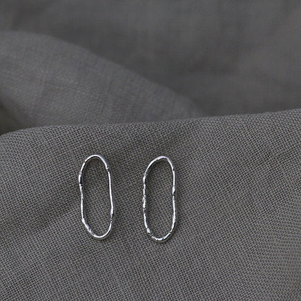 Textured loop earrings made out of recycled silver by April March Jewellery, sold by Percy Langley