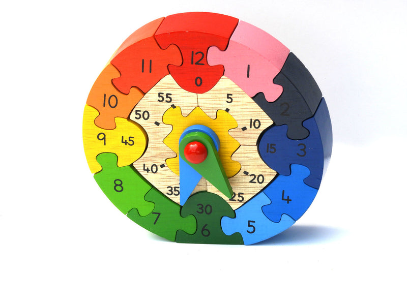 Wooden teaching clock puzzle with hour and minute hands by Best years. This pre-school educational toy is both a puzzle and a teaching clock. Handmade and fair trade, this traditional wooden toy would make an ideal gift. Suitable as a vegan toy Fair trade Safety tested as suitable from birth and painted with non-toxic paints. The wood used is upcycled and sustainably sourced. Approximate dimensions: 17cm x 17cm x 3cm Please note this product is handmade so dimensions can vary and are given as a guide only.