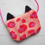 Children's Gorgeous cross body purse in fun leopard print velvet.  This design by Julia Staite has three contrasting print colours, a neon pink shoulder strap and pale pink lining. This snap close bag is sure to jazz up any outfit. Bag size approx. 14cm x 10cm. Strap length approx. 58cm.