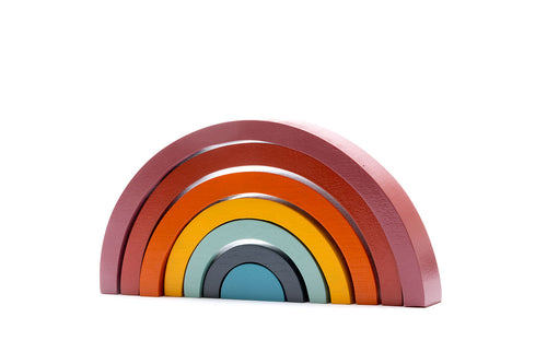 Funky wooden stacking rainbow toy available in 3 colour options.  Ideal for the modern nursery, this traditional wooden toy is handmade and fair trade. Great for open ended play, the wooden rainbow stackers can be used as bridges, fences, tunnels and can be stacked and balanced.   These wooden toys are suitable from birth, safety tested and painted with non-toxic paints.