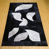 3x4 black and white animal hide leather rug