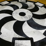 Propeller Black - Handmade Animal Hide Area Rug - 6' Round - The Loom