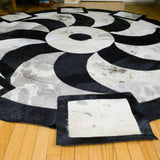 Propeller Black - Handmade Animal Hide Area Rug - 8' Round - The Loom