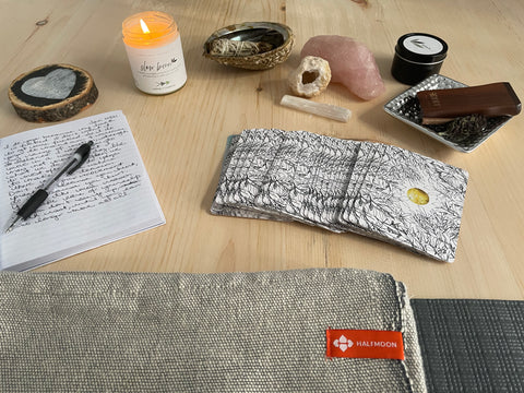 Yoga + journalling with candles and cards