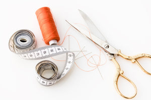 Measuring tape, scissors, thread and needle