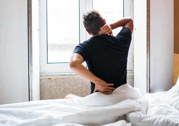 Is a firm mattress better for a sore back?