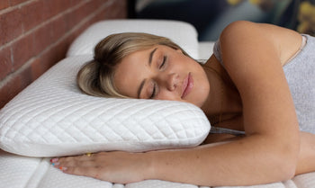 Shows young female sleeping on Sherman memory foam pillow