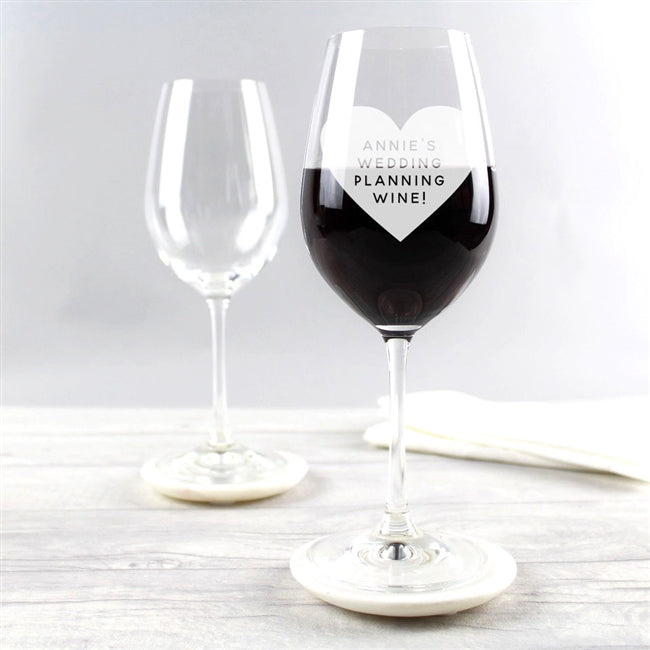 Wine glass engraved with message inside heart design. We can engrave up to 75 characters in a contemporary font.