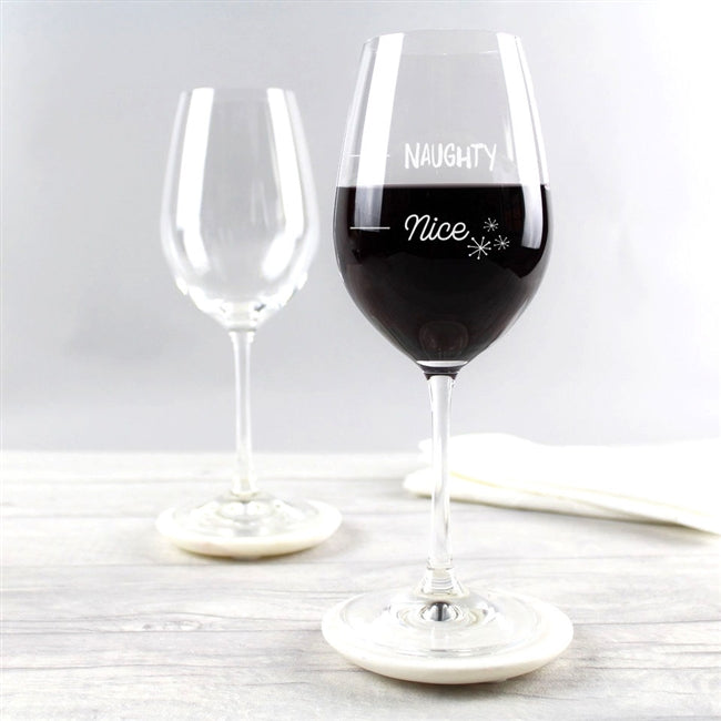 Wine glass engraved with Naughty or Nice Measure. Packaged in bubble wrap inside a sturdy box.
