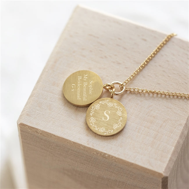 A beautiful gold filled curb chain featuring two gold filled pendants, one expertly engraved with an intricate floral wreath surrounding an initial of your choice and the other with an engraved message of up to 30 characters. A beautiful gift for a Mother or friend, no matter the occasion.