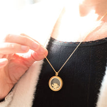 Load image into Gallery viewer, A gold plated brushed stainless steel locket filled with 4 raw brass jigsaw pieces. Hanging from an adjustable 18-20 inch long yellow gold plated curb chain.