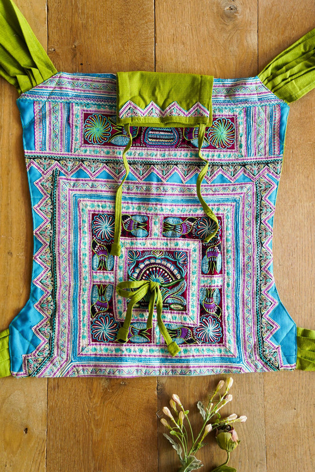Handmade with a vintage Hmong tribe hand embroidery and Hemp Slings. One of a kind Ergonomic Babycarrier.  Mamma Nomad is rooted with Ethical values and growing forth the Sustainable way.