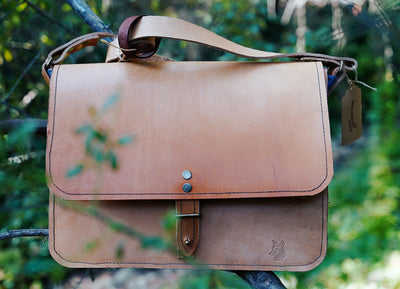 Leather messenger bag in tan color