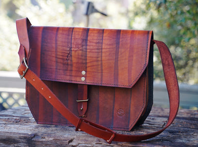 Leather messenger bag in brown color