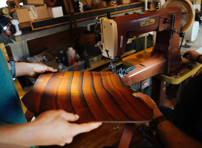 Sewing a piece of leather using a leather sewing machine