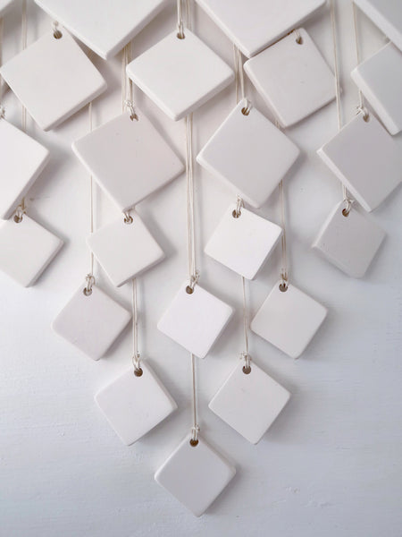 Square V Resin Wall Hanging in White Detail