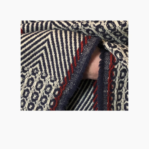 detailed picture of red selvedge detail on our poncho Belmonte
