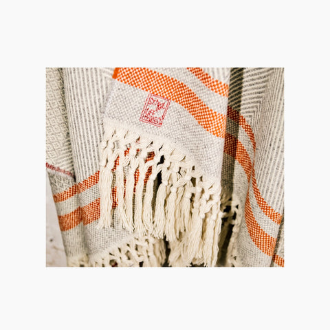 detail of poncho Serra da Estrela; you can see the embroidery and hand knotted fringes