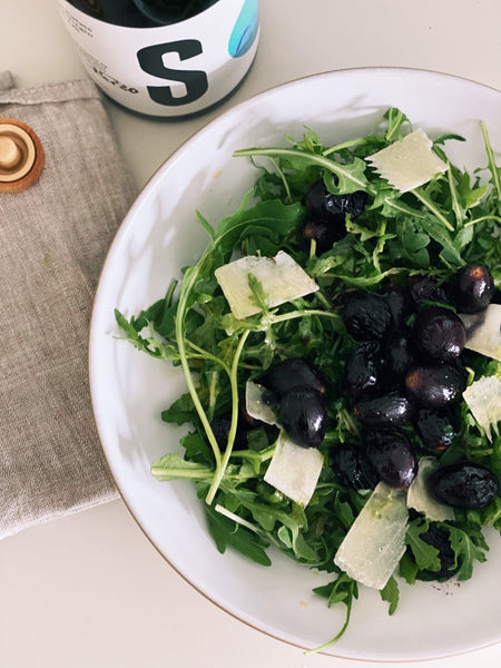 Roasted grapes on a salad of extra virgin olive oil