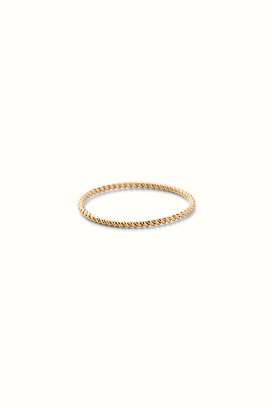 a gold filled slim twisted wire finger ring on a white background