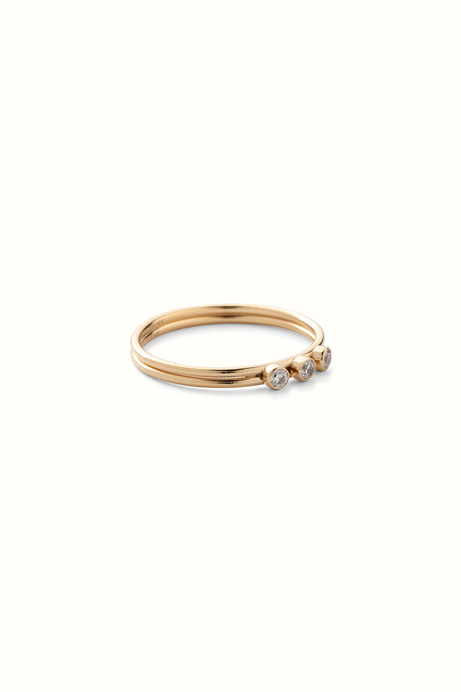 gold filled ring with 3 zirconia gemstones on a white background